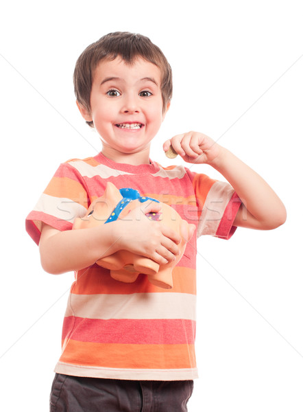 Litle boy puts the coin into the piggy bank Stock photo © pekour