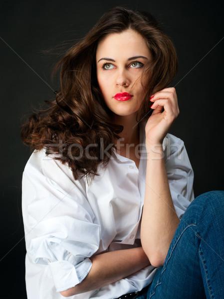 Portré gyönyörű fiatal nő hosszú haj farmer fehér Stock fotó © pekour