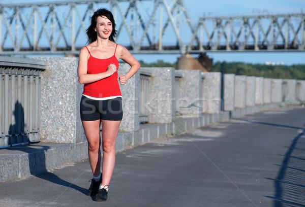 Woman race walking at the embankment Stock photo © pekour
