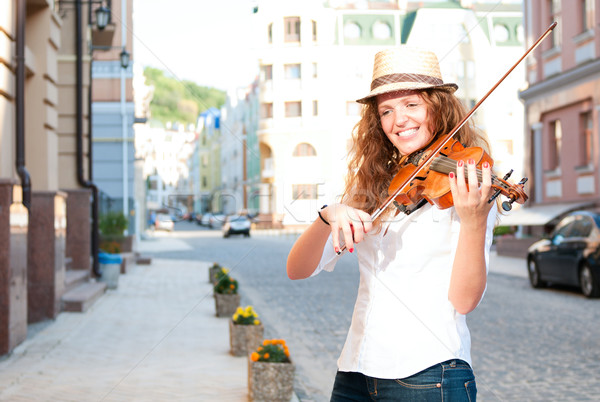 Woman play violin on the street Stock photo © pekour