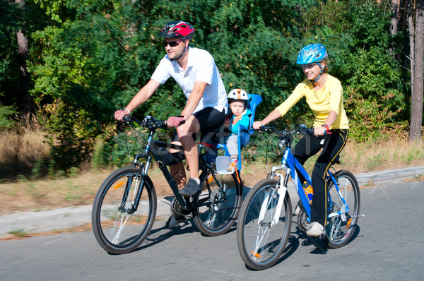 Family on the bikes in the sunny forest Stock photo © pekour
