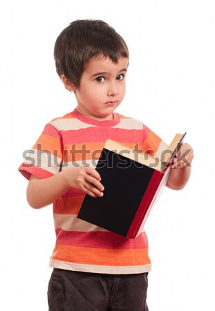 Little boy looks aside while reading book Stock photo © pekour