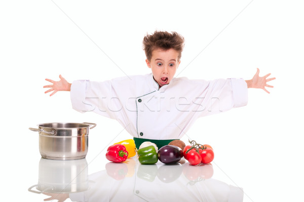 Little boy chef in uniform cooking vegatables shocked Stock photo © pekour