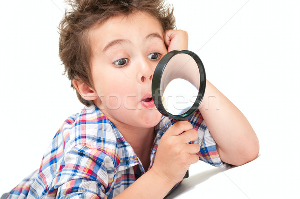 Surprised little boy with weird hair and magnifier Stock photo © pekour