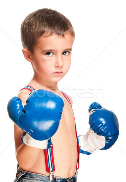 Little bully boy with black eye in boxing gloves fighting stance Stock photo © pekour