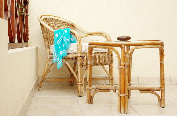 Cane chair and table with forgotten neckerchief Stock photo © pekour