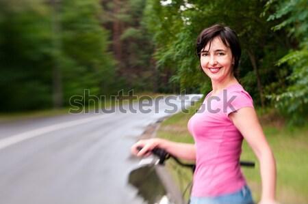 Nő bicikli esős erdő út hatás Stock fotó © pekour