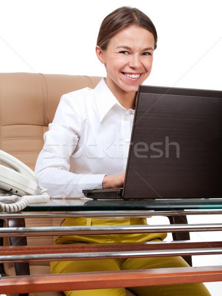 Boldog nő számítógéppel iroda munkahely izolált fehér Stock fotó © pekour