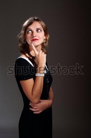 Retro kadın siyah elbise düşük anahtar Stok fotoğraf © pekour