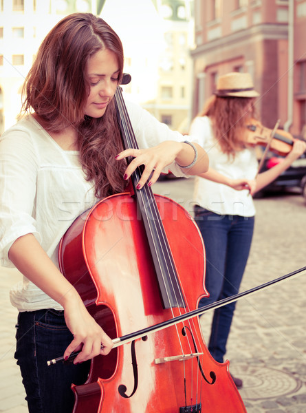Two women strings duet playing violin and cello on the street Stock photo © pekour