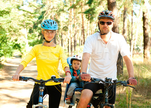 Family on the bike in the sunny forest Stock photo © pekour