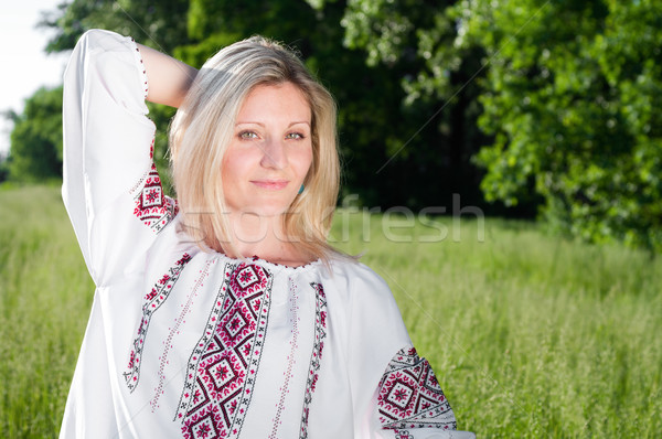 Ukrainian woman outdoors on the meadow Stock photo © pekour