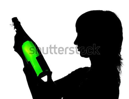 Sziluett nő áramló pezsgő üveg izolált Stock fotó © pekour