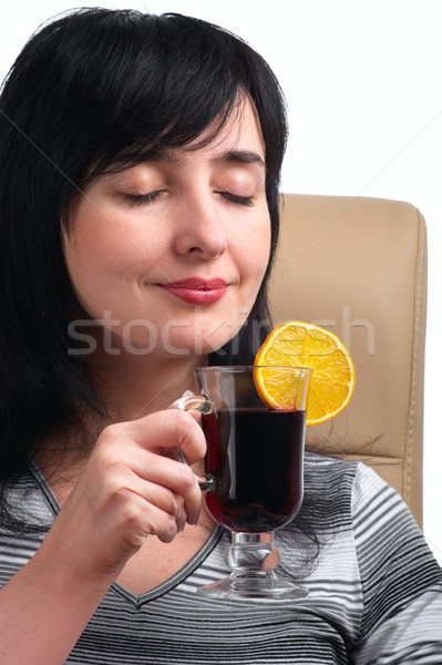 Morena mulher vinho fatia de laranja sessão couro Foto stock © pekour