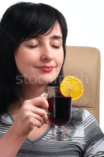 Bruna donna vino fetta d'arancia seduta pelle Foto d'archivio © pekour