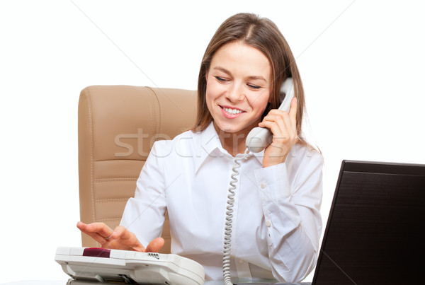 Smiling woman dial phone in the office workplace Stock photo © pekour