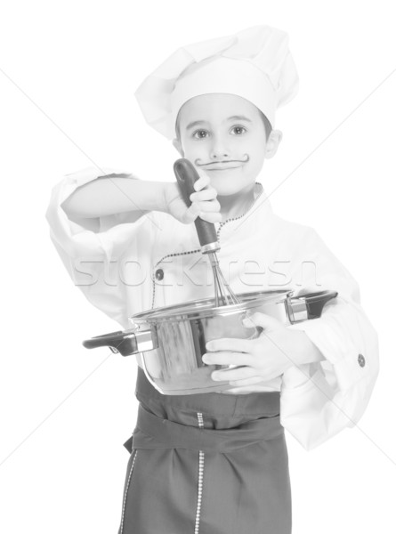 Little chef with kitchen utensil cooking Stock photo © pekour