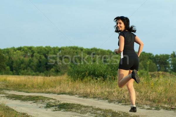 Woman jogging outdoors turn around Stock photo © pekour