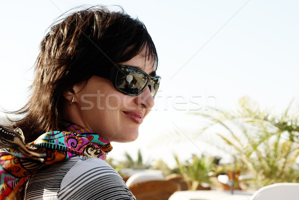 Beautiful woman in neckerchief and sunglasses Stock photo © pekour