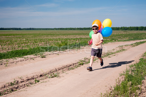 Küçük erkek renkli balonlar çalışma Stok fotoğraf © pekour