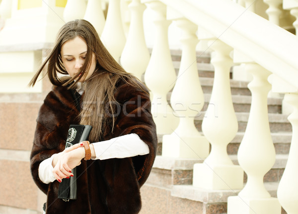 Woman looks at her watch by balustrade Stock photo © pekour