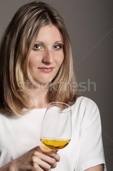 Sceptic woman tastes white wine  Stock photo © pekour