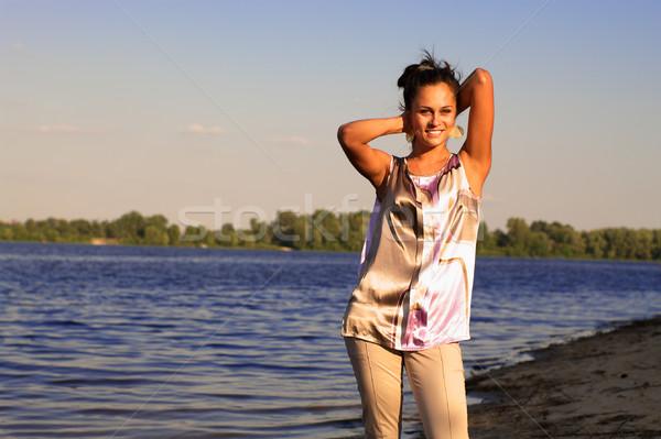 Güzel kız nehir kıyı gün batımı rays su Stok fotoğraf © pekour