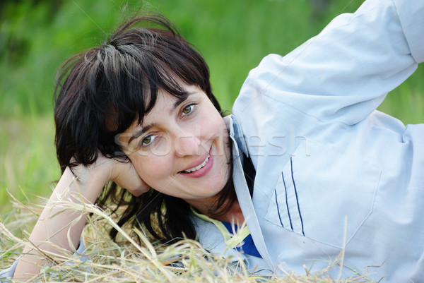 Stock photo: Playful woman lying on the hay