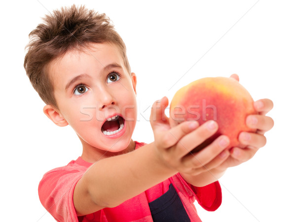 Stock photo: Little naughty boy outstretch the peach