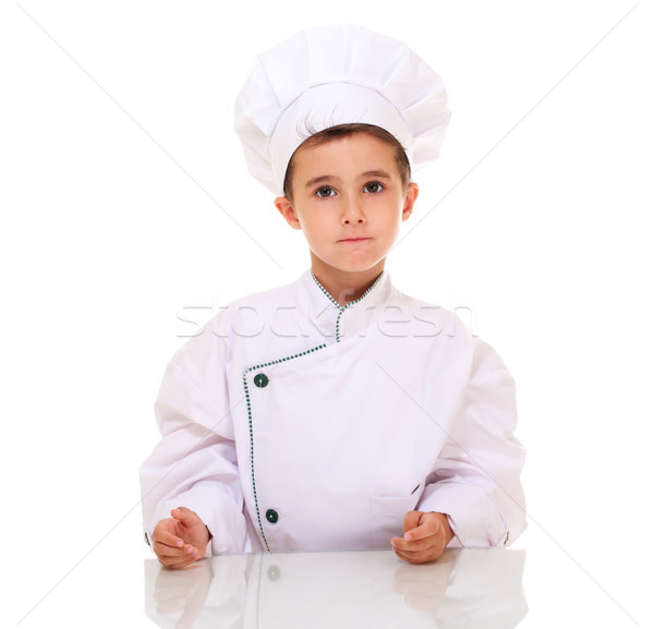 Little boy chef in uniform looking at camera Stock photo © pekour