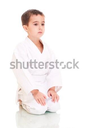 Karate erkek oturma beyaz kimono yalıtılmış Stok fotoğraf © pekour