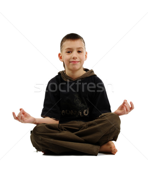 Békés fiú jóga póz mosolyog izolált fehér Stock fotó © pekour