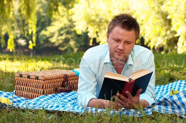 молодым человеком книга парка студент осень исследование Сток-фото © pekour