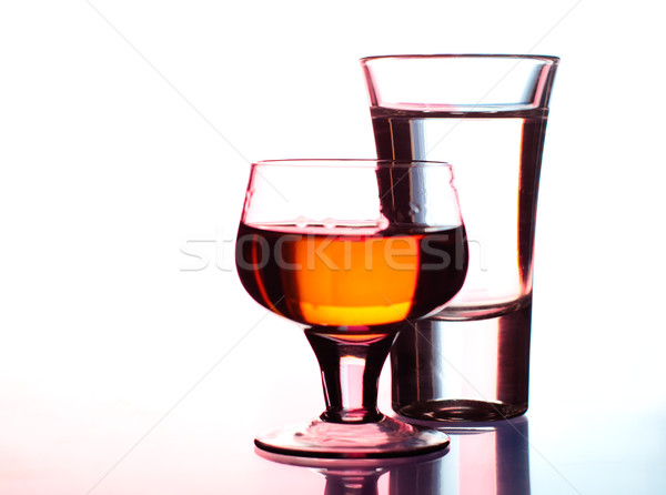 Shots of vodka and whiskey in club light Stock photo © pekour