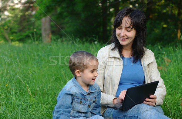 Mother and son with laptop outdoors Stock photo © pekour