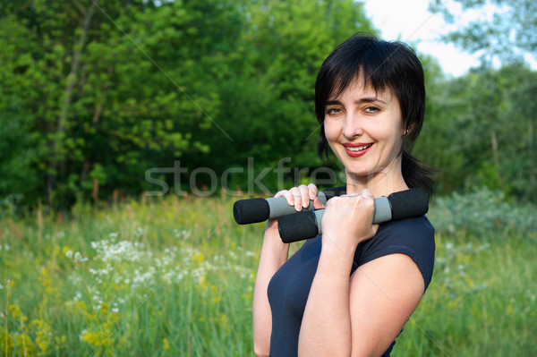 Woman with dumbbells outdoors Stock photo © pekour