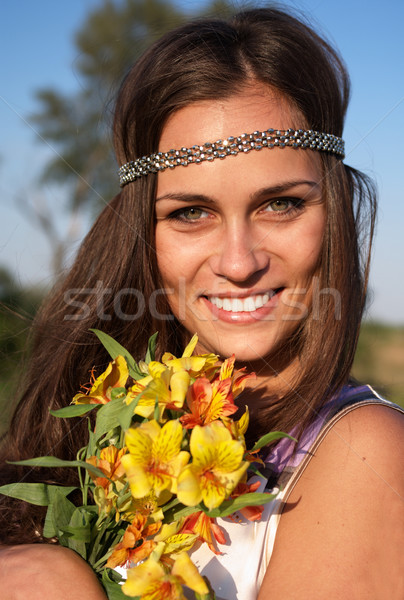 Hippie girl with lily outdoors Stock photo © pekour