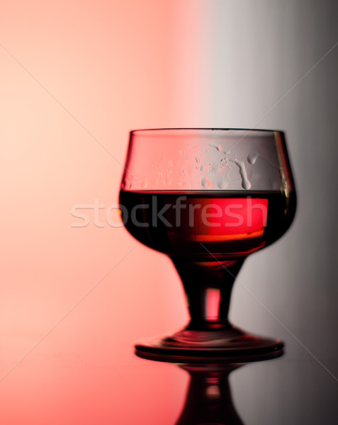 Cognac glass backlit by red and blue Stock photo © pekour