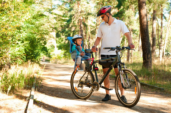Father and little son on bike with child seat Stock photo © pekour