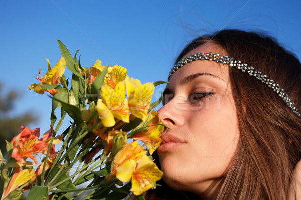 Hippie girl smells lily Stock photo © pekour