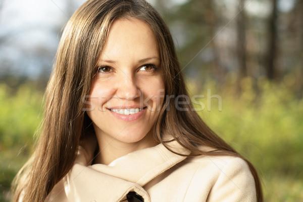 Fiatal nő kint zöld legelő erdő mosoly Stock fotó © pekour