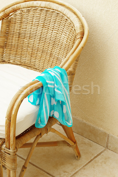Cane chair with forgotten neckerchief Stock photo © pekour