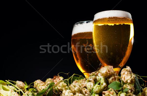 Dois óculos cerveja salto preto beber Foto stock © pekour