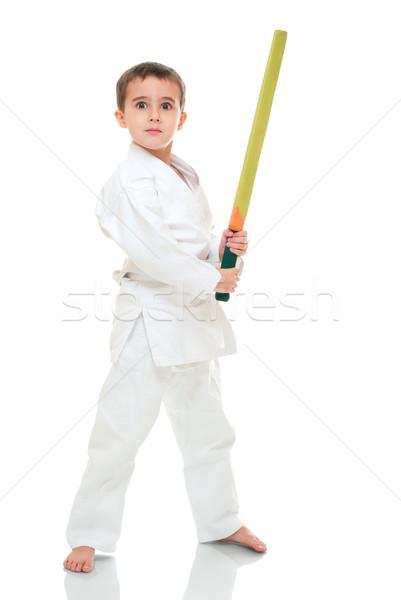 Karate boy with toy sword in white kimono Stock photo © pekour