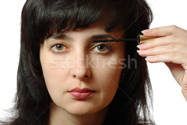 Beautiful brunette woman makes up eyelashes isolated on white Stock photo © pekour