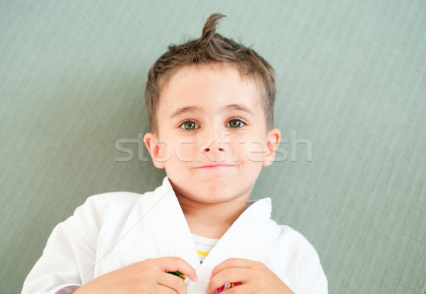 Karate boy relaxing in sport hall Stock photo © pekour