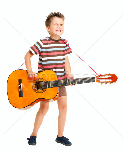 Little boy plays guitar country style Stock photo © pekour