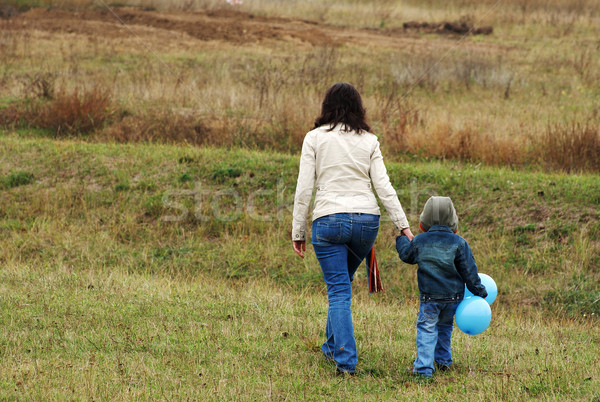 Woman and boy on the meadow Stock photo © pekour