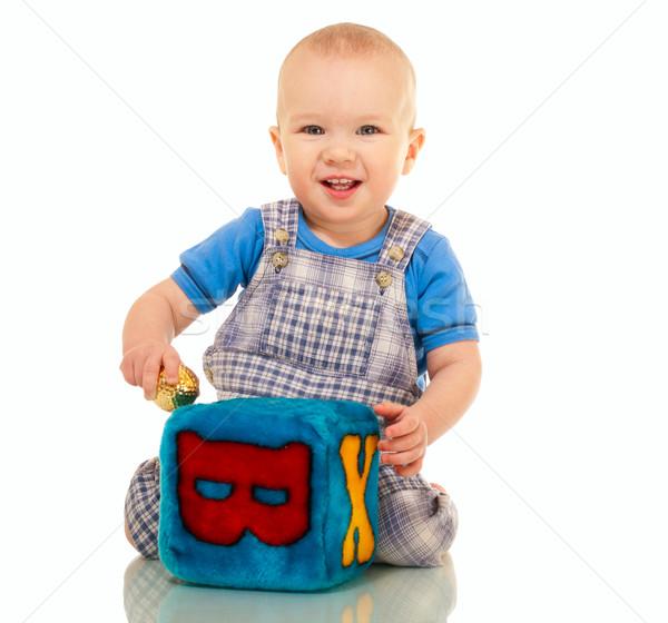 Boldog kicsi fiú átfogó játékok izolált Stock fotó © pekour
