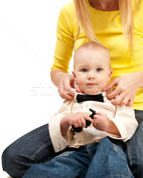 Mom adjusting bow tie for her baby Stock photo © pekour